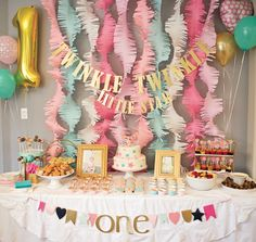 Pink and Gold Twinkle Twinkle Little Star Birthday Party - we love the fringed streamers as a backdrop!