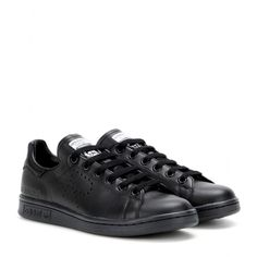Adidas by Raf Simons - Stan Smith leather sneakers - If they're good enough for Phoebe Philo, they're good enough for us. We love Adidas's 'Stan Smith' sneakers, crafted from black leather for a suitably downplayed retro vibe. They'll fast become your ultimate staple - they really do go with everything. seen @ www.mytheresa.com