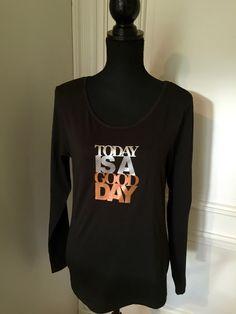 Zwart longsleeve shirt met mooie positieve tekst.