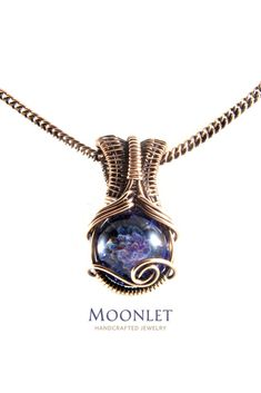 by MOONLET HANDCRAFTED JEWELRY Blue Floral Glass Antique Copper Pendant Necklace Wire Wrap Jewelry