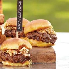 Carolina Sliders: Prepared from a blend of pork shoulder and short rib meat, these petite burgers boast an exceptionally moist texture and robust flavor. They're topped with a Carolina-style coleslaw and a spicy-sweet barbecue sauce just before serving.