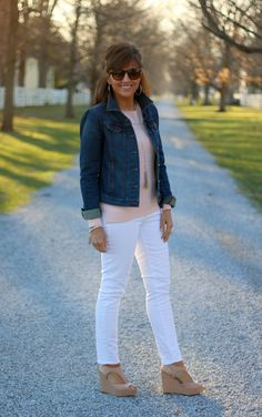Light pink pullover,  white jeans,  denim jacket,  nude wedge sandals,  tassel necklace