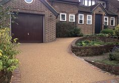Resin Bound Gravel Driveway in Bronze Trio colour, Reigate, Surrey installed by Clearstone Permeable Driveway, Resin Driveway, Gravel Driveway, Gravel Patio, Concrete Patio, Resin Gravel, Resin Bound Gravel, Resin Bound Driveways, Landscaping Near Me