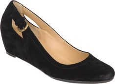 These pumps feature a rounded toe, wedge heel, dual cutout detailing on sides, and a buckle ornamentation.
