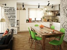 Bright green Eames-inspired chairs are just a bit different and the perfect level of modern for this small, artsy apartment.