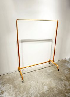 Rolling Clothing Rack • Copper & Wood
