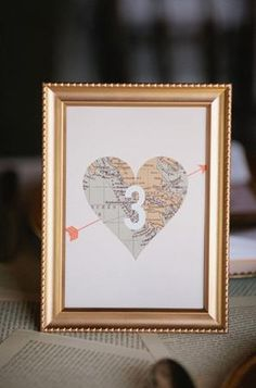 Framed map heart as table number.