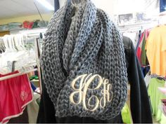 Knitted scarf with monogram.