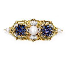MARCUS & CO. | 18 KARAT GOLD, NATURAL PEARL, SAPPHIRE, DIAMOND AND PLIQUE-À-JOUR ENAMEL BROOCH. Of elongated form, centering a button-shaped natural pearl, flanked by two semi-baroque natural pearls, decorated with florets set with two cabochon purple sapphires and 14 cabochon blue sapphires, accented by old European-cut diamonds, highlighted with transparent plique-à-jour enamel featuring flecks of platinum, signed Marcus & Co.; circa 1897.