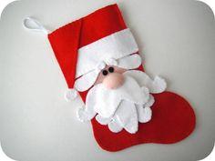 Bota em feltro com aplicação de papai Noel - Enfeite de Natal  Tamanho aprox.: 23 X 16,5 cm.  Antes de enviar o seu pedido, leia as políticas da loja na página principal! R$ 22,00