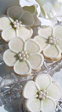 how about cookies instead of cake? Green Flower The perfect gift, favour or place setting. Beautifully decorated to compliment your theme, cookies are available in lemon, vanilla or slightly spiced. Bagged and tied with ribbon to match Fancy Cookies, Cut Out Cookies, Iced Cookies, Cute Cookies, Easter Cookies, Royal Icing Cookies, Cookie Desserts, Cupcake Cookies, Christmas Cookies