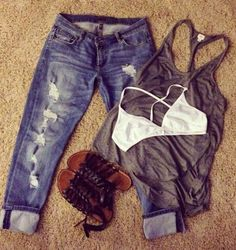 I would totally rock this. Ripped jeans, dark, gray tank & cute sandals<3