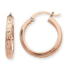 You won't find hoops anywhere else that are as sultry as our Diamond Cut Inside/Outside Hoop Earrings in 14k Rose Gold. Silky and smooth rose gold, combined with the sharp edges of a diamond cut design, these hoops have the best of everything.