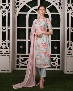 Beautiful ice blue color kurti and cigarette pants with blush pink color dupatta. Kurti with floral print.  23 August 2019