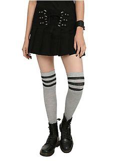 "Black skirt from Royal Bones with strap and lace-up detailing, silver tone hardware, pleats and back zipper closure.<ul><li> 13"" long</li><li>97% cotton; 3% spandex</li><li>Hand wash cold; dry flat</li><li>Imported</li></ul>"
