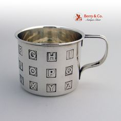 American sterling silver Alphabet baby cup by the Thomae Company c.1940.