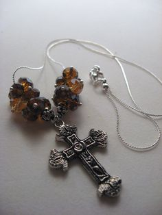 Amber Cross Necklace $15 A beautiful antique nickel lead free cross decorated with a rose is