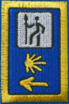 (http://www.spanishdoor.com/camino-de-santiago-pilgrim-cloth-patch-st-james-3-road-marker/)