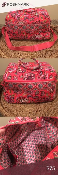 SALE Vera Bradley weekender in Call Me Coral The pattern is called Call Me Coral. It's a very pretty bright pinkish coral color. Used a few times. It comes with the adjustable shoulder strap and has 3 outer pockets, one with a zipper. The inside it has 4 pockets. It does fit as a carry on in the airplane. Great for a weekend get away!! Vera Bradley Bags Travel Bags