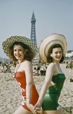 Innocent pleasures: Two girls strike a pose in front of the famous Blackpool Tower (left) ...