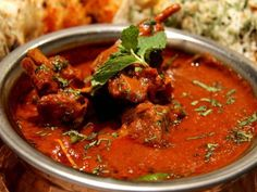 The word vindaloo is derived from the Portuguese words for Vinegar (Vinho) and Garlic (or Al'ho). Vindaloo was carried by Portuguese sailors on their sailing Lamb Dishes, Thai Dishes, Indian Food Recipes, Vegetarian Recipes, Ethnic Recipes, Marinated Lamb, Rogan Josh, Vindaloo, Lamb Curry