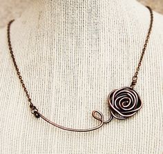 This charmingly simple necklace has been crafted out of 14 gauge copper wire. After being hand-formed, I oxidized it and then polished it to