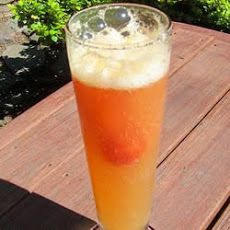 Brenda's Strawberry Slush Delight: 3 cups sugar 6 cups water 46 ozs pineapple juice 12 ozs frozen lemonade concentrate 24 ozs juice concentrate (frozen orange) 1 qt strawberries (fresh or frozen pureed in a blender) 2 cups rum (taste) 4 liters soda (chilled)