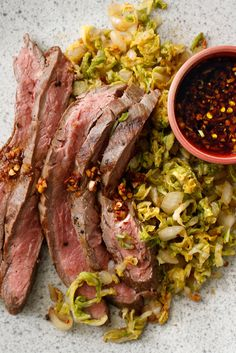 It is easy enough to take the basic ingredients and flavors of kimchi and create a fast cabbage salad that puts ordinary coleslaw to shame. Use it as a bed for grilled beef – or anything else that has the flavor to stand up to it – and you have a great summer dish. (Photo: Craig Lee of The New York Times)