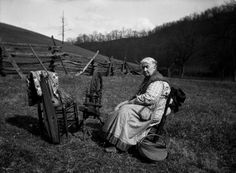 Cynthia Rice with spinning wheel, basket, woven spread, and dulcimer. KY. 192-? - 1932. Kentuckiana Digital Library.