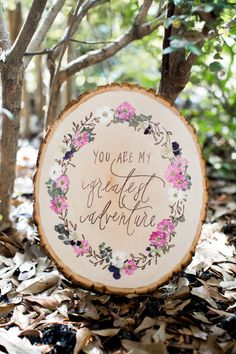 This listing is for a custom designed wood burned sign with a wreath of wood burned leaves and pressed flowers and greenery.