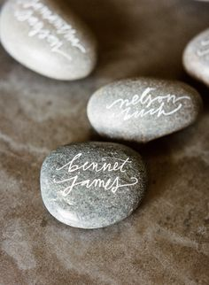 Name on the stone, gift to take home and place card. For the beach bride. DIY Wedding Ideas   Wedding Blog   Used Wedding Dresses   Once Wed