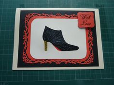 Iris folding black glitter paper folded boot matted & layered on a red Spellbinder Decorative Labels 8 die cut background