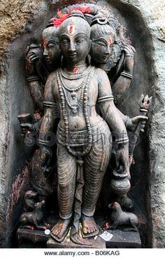 Trimurti temple statue with Brahma , Shiva and Vishnu making the supreme being, India - Stock Image