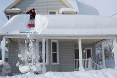 Heavy snow on top of a home How much Snow is Too Much Snow on your Roof? #http://michellemiller2.xactsite.com/ #FrederickMaryland #REALTOR®