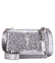Saint Laurent - Sunset Medium shoulder bag - Coated in dazzling silver-tone glitter, this piece sits at the acme of after-dark glamour, while the iconic YSL logo brings instant recognition. Watch yours transform your favourite LBD. - @ www.mytheresa.com