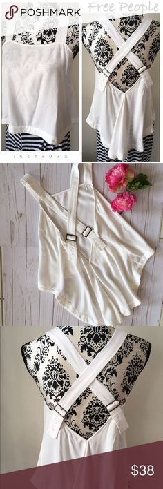 "Free People hi-lo cross strap top Loose flowing off white cross strap top. Adjustable brass strap buckles in back. Measurements laying flat: armpit to armpit 16"", front length from top of bodice 13 1/2"", hangs longer in back. Free People Tops"