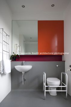 Procter:rihl GREY WHITE AND RED BATHROOM.