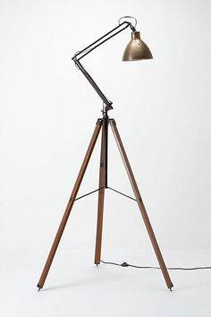 Architect Tripod Lamp $698.00  You don't need to be a famous architect to add a little architectural style to your room or office. The Architect Tripod Lamp will give any space a sophisticated and classic style. This brass desk light is perched above an industrial three-legged wood base, giving you the illumination to complete whatever [...]