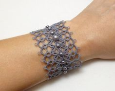 Tat Jewelry Lace Cuff Bracelet -Obsession handmade many color choices fancy modern lace bridal formal or casual wear strong original design Tatted bijoux dentelle Cuff Bracelet-Obsession MTO par SnappyTatter Items similar to Tatting jewelry lace Bracelet Bold Jewelry, Lace Jewelry, Jewelry Bracelets, Handmade Jewelry, Jewelry Design, Indian Jewelry, Bracelet Crochet, Lace Bracelet, Needle Tatting