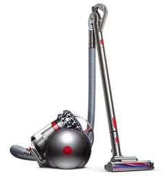 Dyson Cinetic Big Ball Vacuum - The latest from Dyson is one of the brand's most advanced products yet; a compact filter-less vacuum cleaner that delivers the proven power of clog-free Cyclonic Action suction and a rolling canister that will never tip over. The design creates a super-low center of gravity for the motor, cords & other components, so you can drag it freely around the house power-vacuuming every square inch.