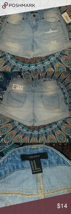 White wash denim shorts Brand new with tags. Never worn! Size 26  Jean shorts, white, blue, distressed, holes, 5 pockets, clean no stains Discounts on bundles !  ****Please ask any and all questions before making an offer*** Forever 21 Shorts Jean Shorts