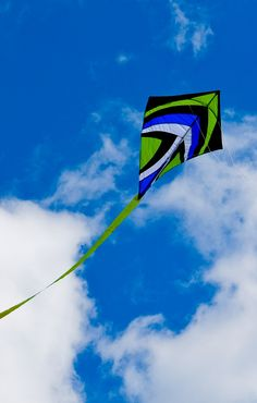 """Not sure if this Diamond kite is retail or a home-build - but I like the use of non-commercial colors! With that curved horizontal spar this Diamond would have a substantial wind range too... T.P. (my-best-kite.com) """"Drache am Himmel"""" Cropped from a photo by Markus Wollny on Flickr (cc)."""