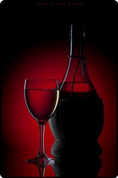 Wine on a red background  by Pavel Bugrov on 500px