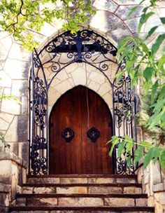 Erich Riesel's creative iron grill and fixtures frame the entrance to the Chapel where Mo-