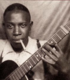 Robert Johnson - early, maybe the first, blues guitarist whose music paved the way for rock and groups such as Led Zeppelin