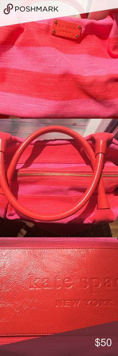 """Classic kate spade """"Stevie"""" style handbag. This handbag adds the fun in function! Canvas pink and red stripe with red leather handles, side trim, inside pocket/zipper trim, and leather embossed with kate spade logo on bottom. Blue nylon interior with a zipper pocket at rear and 2 small open pockets at front as is customary in all kate spade bags. Roomy without being too big! Can go over shoulder but best if held on forearm. This is a true classic! Used only 2 times! kate spade Bags Satchels"""