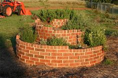 Imagine a long garden row, about 25 feet long. Then, take that row and coil it around and upward into a spiral. Click through to see how Texas gardener Dave Whitinger created this herb spiral.