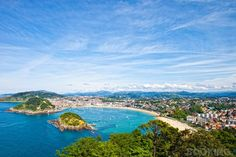 Beautiful white-sand beach opening onto a crescent-shaped bay in San Sebastian, Spain!