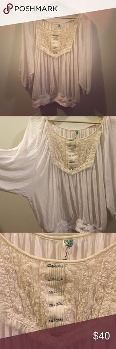 Free People Boho Lace sequin Top Super airy and flowy top from Free People. Boho style. Lace neckline with sequins. Cream and offwhite. One discolored area on Sleeve, but easily hidden due to flowy oversized design. Size label removed, it is a small but can easily fit a medium. Free People Tops Blouses