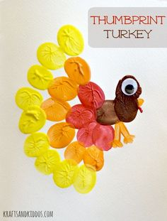 Thumbprint Turkey from Krafts and Kiddosand other adorable Thanksgiving crafts for kids